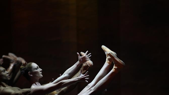 In this photo taken Thursday, Sept. 18, 2014,  dancers of the Joburg Ballet takes part in The Nutcracker Re-imagined dress rehearsal , in Johannesburg, South Africa, ahead of five performance to be performed starting Friday, Sept 19, 2014. The production includes acrobatics and African themes added to give local flavor such as gumboot dancing. (AP Photo/Denis Farrell)