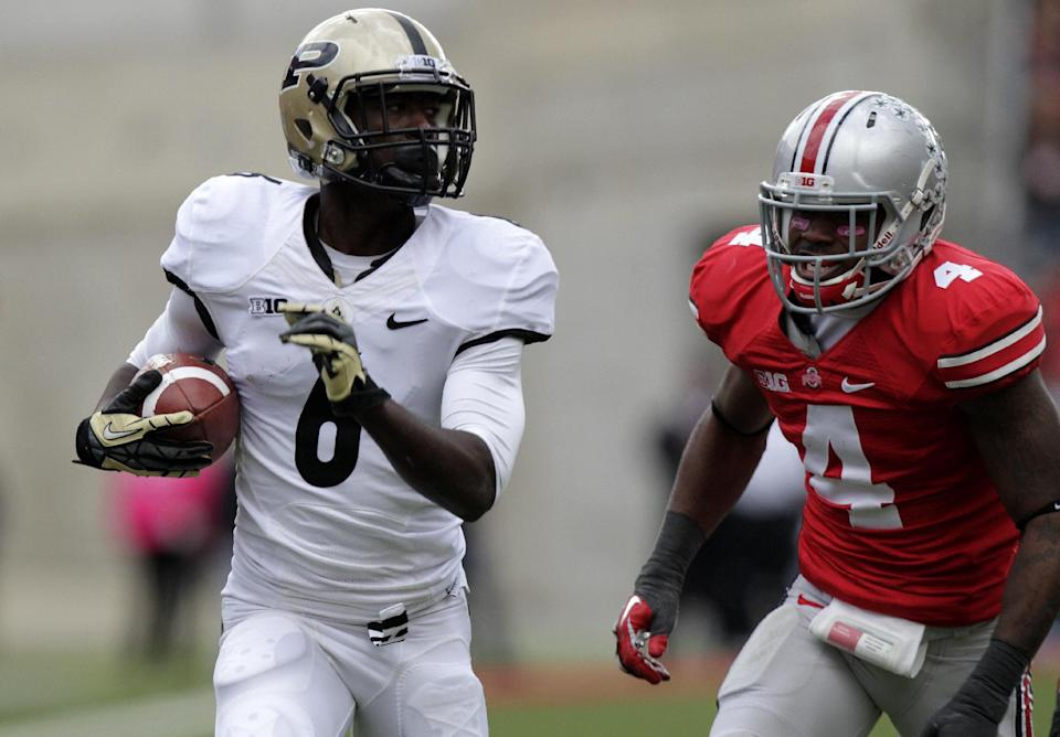Purdue wide receiver Gary Bush, left, outruns Ohio State defensive back C.J. Barnett on his way to a touchdown during the third quarter of an NCAA college football game Saturday, Oct. 20, 2012, in Columbus, Ohio. Ohio State beat Purdue 29-22 in overtime. (AP Photo/Jay LaPrete)