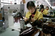 This file photo shows a factory worker stitching leather shoe uppers on a production line at a shoe factory in the Chinese city of Wenzhou, in 2006. Rapid wage increases are threatening China's competitiveness, but improved productivity and other advantages mean it will continue to attract investors, analysts say