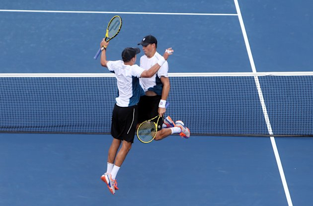 Sep 1, 2014; New York, NY, USA; Mike Bryan (USA), left, and Bob Bryan (USA), right, celebrate after recording match point against Bradley Klahn (USA) ...