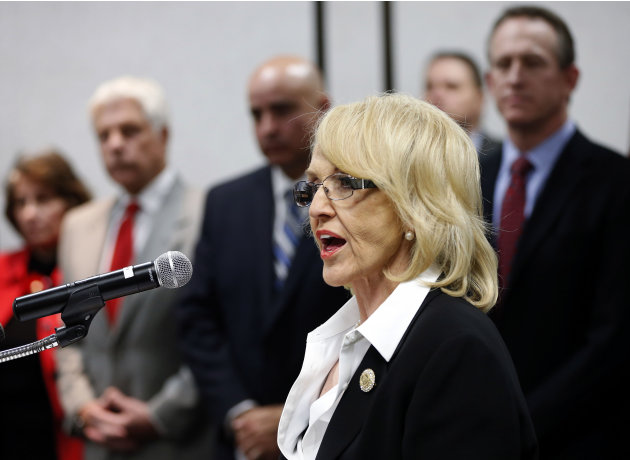Arizona Gov. Jan Brewer, R, calls for the expansion of Medicaid, Wednesday, Jan. 26, 2013 in Phoenix with healthcare and business leaders at Maricopa Medical Center. An expansion would call for $8 bil