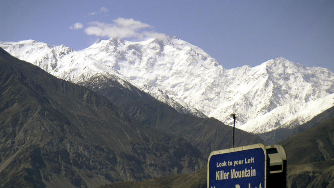 CORRECTS THE NUMBER OF THE KILLED FOREIGN TOURISTS - FILE - In this May 4, 2004 file photo, Nanga Parbat, the ninth highest mountain in the world, is seen from Karakorum Highway leading to neighboring China in Pakistan's northern area. Gunmen wearing police uniforms killed nine foreign tourists and one Pakistani before dawn Sunday, June 23, 2013 as they were visiting one of the world's highest mountains in a remote area of northern Pakistan, officials said. (AP Photo/Musaf Zaman Kazmi, File)