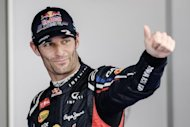 Red Bull-Renault&#39;s Australian driver Mark Webber shows his delight after taking the pole position for the Formula One Korean Grand Prix in Yeongam on October 13. Webber pipped his team-mate and reigning champion Sebastian Vettel to the line Friday to grab pole position for Sunday&#39;s race, ensuring a front-row lock-out for Red Bull