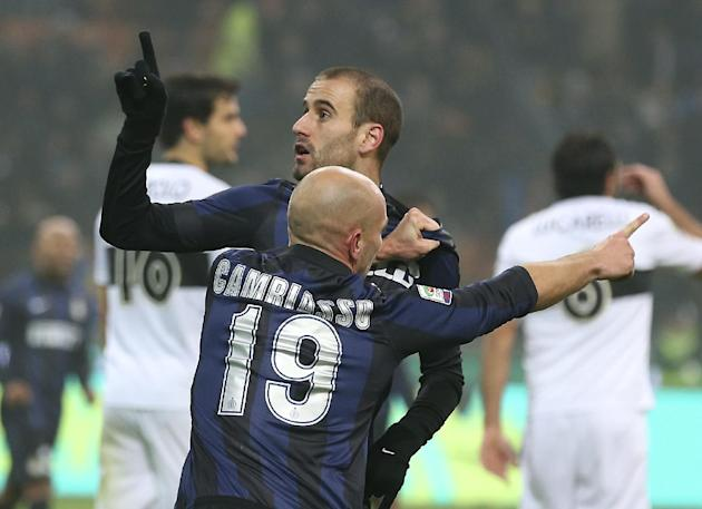 Inter Milan forward Rodrigo Palacio, top, of Argentina, celebrates with his teammate Argentine midfielder Esteban Cambiasso after scoring during the Serie A soccer match between Inter Milan and Parma