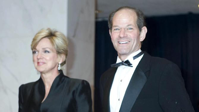 Former New York Gov. Eliot Spitzer, right, and former Michigan Gov. Jennifer Granholm arrives at the White House Correspondents' Association Dinner on Saturday, April 29, 2012, in Washington. (AP Photo/Kevin Wolf)