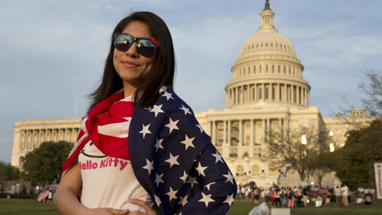 "Felicia Esperanza, 19, of Woodbridge, Va., whose parents are from Mexico and El Salvador, poses for a portrait after attending the ""Rally for Citizenship,"" a rally in support of immigration reform, on Capitol Hill in Washington, on Wednesday, April 10, 2013. Bipartisan groups in the House and Senate are said to be completing immigration bills that include a pathway to citizenship for the nation's 11 million immigrants with illegal status. ""I'm here to support my family,"" says Esperanza, ""so that they can get their citizenship."" (AP Photo/Jacquelyn Martin)"