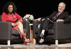 Oprah Winfrey, David Letterman | Photo Credits: Ron Hoskins/Getty Images