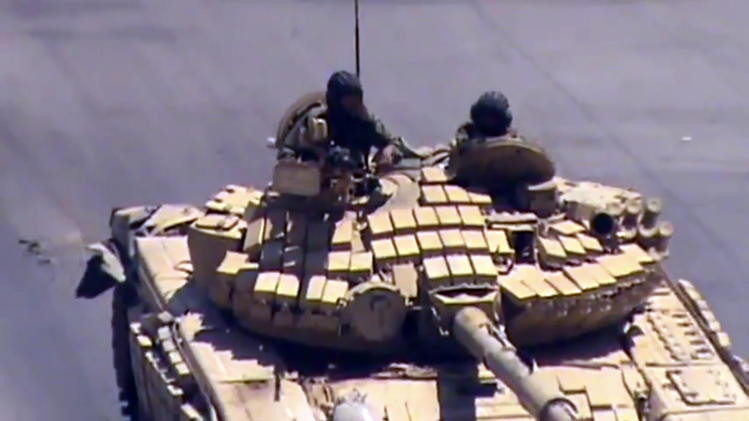 This image made from video provided by Shaam News Network Tuesday, July 17,  2012, purports to show a Syrian tank in Damascus, Syria. (AP Photo/Shaam News Network via AP video) THE ASSOCIATED PRESS HAS NO WAY OF INDEPENDENTLY VERIFYING THE CONTENT, LOCATION OR DATE OF THIS PICTURE.