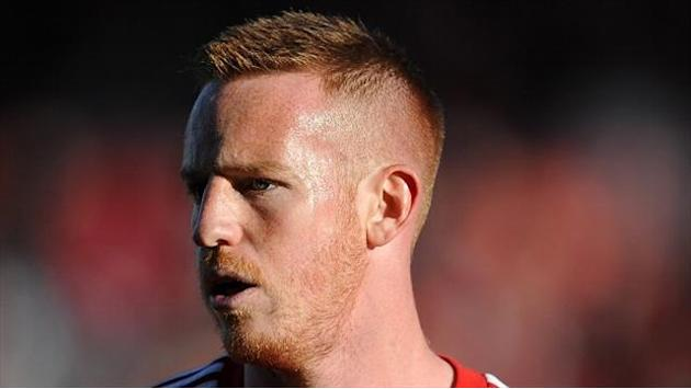 Football - Dons snap up Rooney
