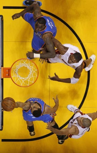 Oklahoma City Thunder Thabo Sefolosha gets off a shot against Miami Heat during the NBA Finals game