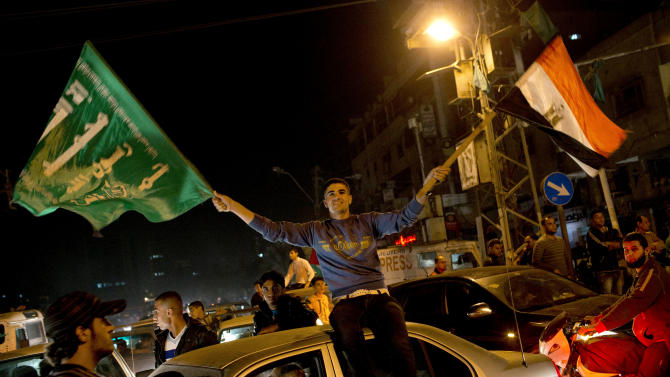 Palestinians celebrate the cease-fire between Hamas and Israel in Gaza City, Wednesday, Nov. 21, 2012. Israel and the Hamas militant group agreed to a cease-fire Wednesday to end eight days of the fiercest fighting in nearly four years, promising to halt attacks on each other and ease an Israeli blockade constricting the Gaza Strip. (AP Photo/Bernat Armangue)