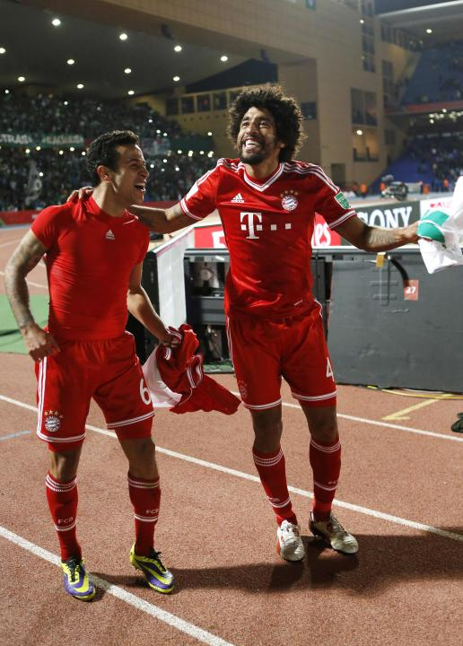 Dante of Germany's Bayern Munich celebrates with his team mate Thiago after winning their 2013 FIFA Club World Cup final soccer match against Morocco's Raja Casablanca at Marrakech stadium
