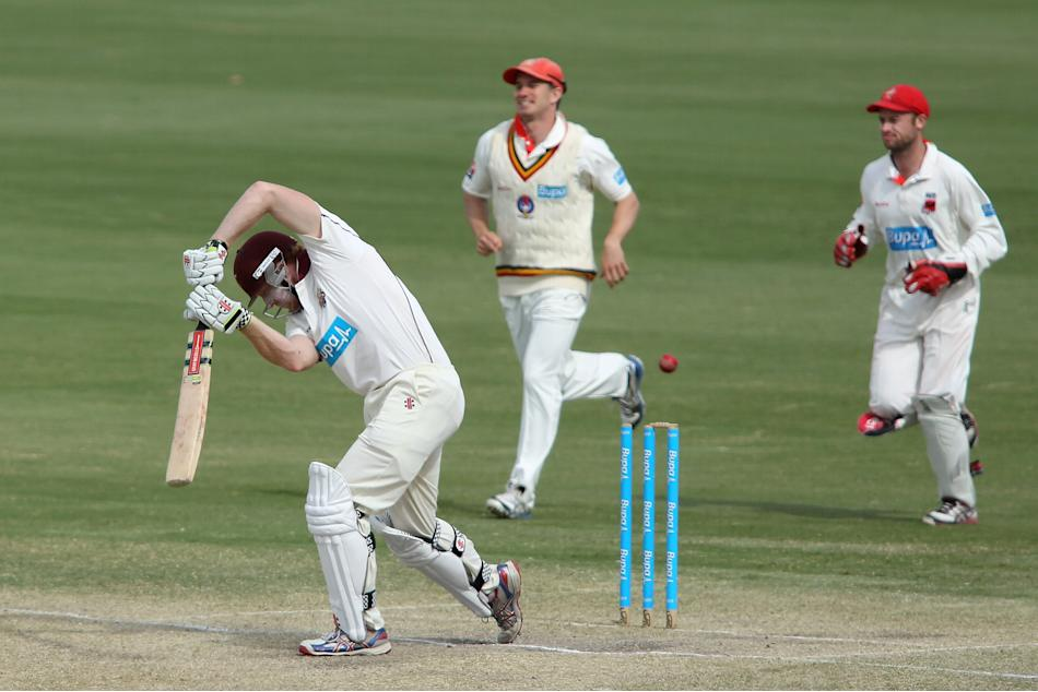 Redbacks players celebrate as Alex Kemp of the Bulls is bowled out during day four of the Sheffield Shield match between the South Australian Redbacks and the Queensland Bulls at Adelaide Oval on Octo