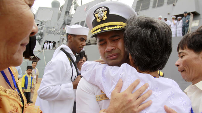 """In this photo taken Dec. 3, 2010, U.S. navy officer Michael """"Vannak Khem"""" Misiewicz becomes emotional as he embraces his aunt Samrith Sokha, 72, at Cambodian coastal international see port of Sihanoukville, Cambodia. Misiewicz passed confidential information on ship routes to Malaysian businessman Leonard Francis' Singapore-based company, Glenn Defense Marine Asia Ltd., or GDMA, according to the court documents. Misiewicz and Francis moved Navy vessels like chess pieces, diverting aircraft carriers, destroyers and other ships to Asian ports with lax oversight where Francis could inflate costs, according to the criminal complaint. The firm overcharged the Navy millions for fuel, food and other services it provided, and invented tariffs by using phony port authorities, the prosecution alleges. (AP Photo/Heng Sinith, File)"""