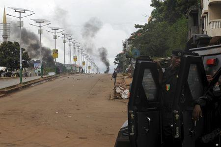 EU observers say Guinea vote valid; opposition protests