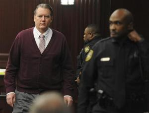 Michael Dunn returns to the courtroom during jury deliberations in his murder trial in Jacksonville, Florida