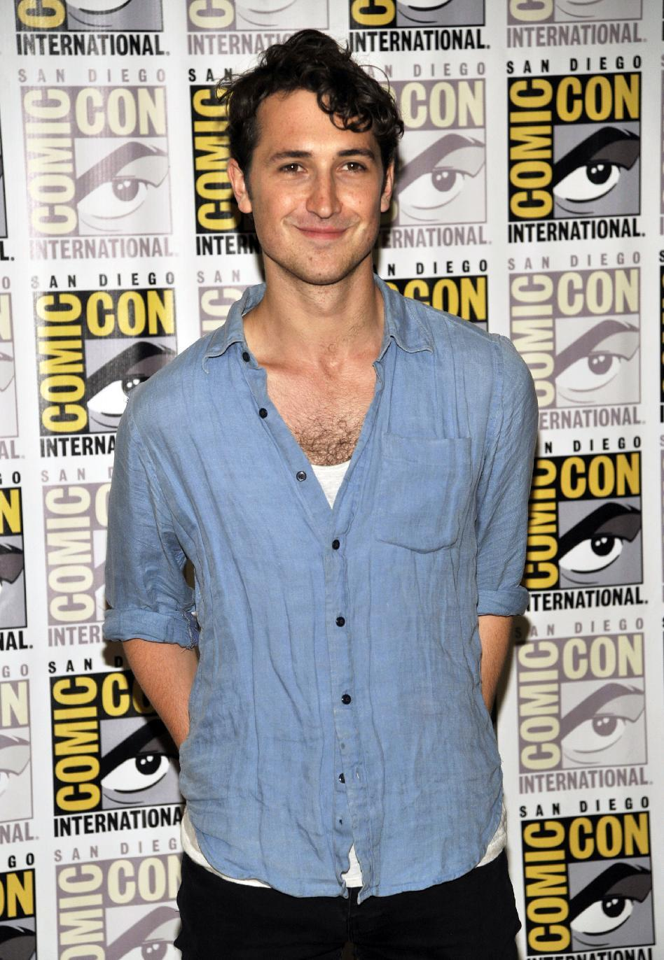 "Ben Lloyd-Hughes attends the ""Divergent"" press line on Day 2 of Comic-Con International on Thursday, July 18, 2013 in San Diego, Calif. (Photo by Chris Pizzello/Invision/AP)"