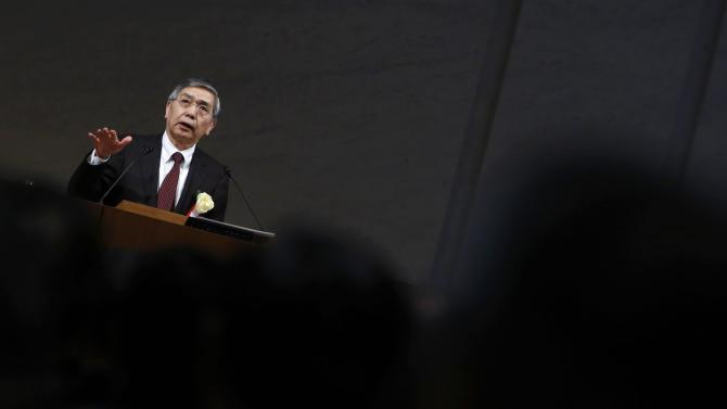 BOJ Governor Kuroda speaks during a year-end meeting at the Japan Business Federation in Tokyo