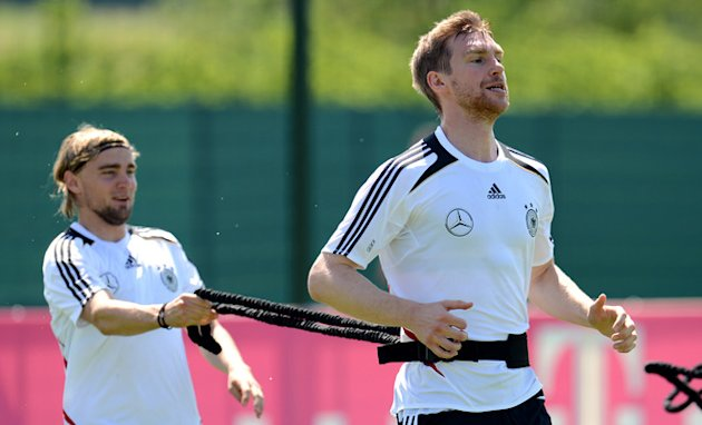 Germany's Defender Marcel Schmelzer (L) And Defender Per Mertesacker Take Part In A Training Session At The EURO 2012 AFP/Getty Images