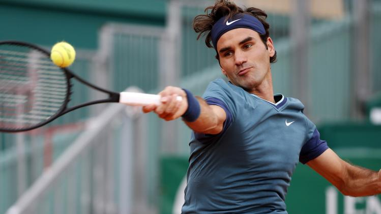 Federer returns the ball to Stepanek during the Monte Carlo Masters in Monaco