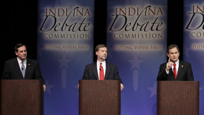 Candidate for Indiana's U.S. Senate seat Republican Richard Mourdock, right, pivots the discussion towards the Affordable Healthcare Act after answering a question on abortion, as fellow candidates Democrat Joe Donnelly, left, and Libertarian Andrew Horning listen during a in a debate in New Albany, Ind., Tuesday, Oct. 23, 2012. (AP Photo/Michael Conroy)