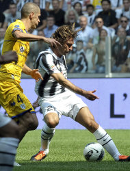 Juventus' Andrea Pirlo, right, vies for the ball with Parma' Stefano Marrone during a Serie A soccer match at the Juventus Stadium in Turin, Italy, Sunday, Sept. 11, 2011. (AP Photo/Massimo Pinca)