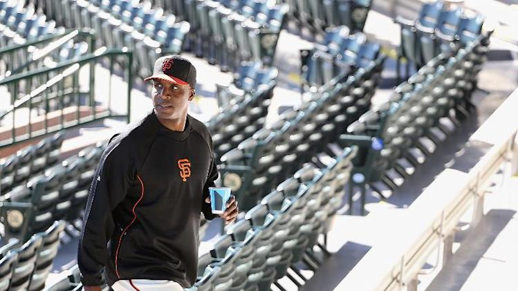 Barry Bonds of the San Francisco Giants arrives to a press conference about his return to the organization as a special hitting coach for one week of Spring Training at Scottsdale Stadium on March 10, 2014 in Scottsdale, Arizona