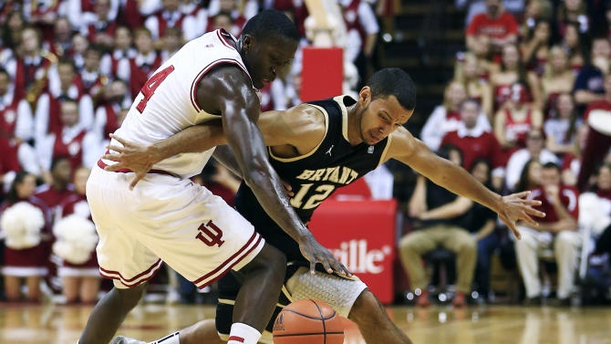 Indiana's Victor Oladipo, left, battles Bryant's Dyami Starks for a loose ball during the first half of an NCAA college basketball game, Friday, Nov. 9, 2012, in Bloomington, Ind. (AP Photo/Darron Cummings)