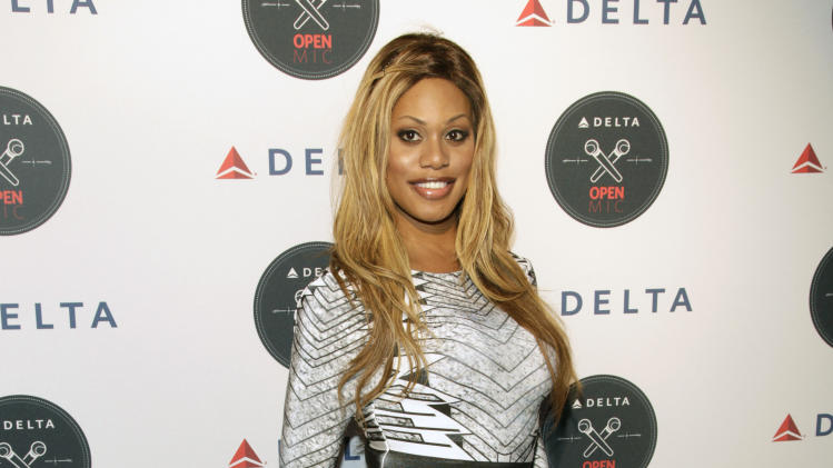 Actress Laverne Cox attends the Delta Open Mic with Serena Williams event Wednesday, Aug. 20, 2014 in New York. (Photo by Andy Kropa/Invision/AP)