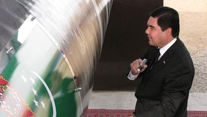 Turkmen President Gurbanguly Berdymukhammedov signs the East-West gas trunk pipeline in Shatlyk on May 31, 2010 during an official launch ceremony