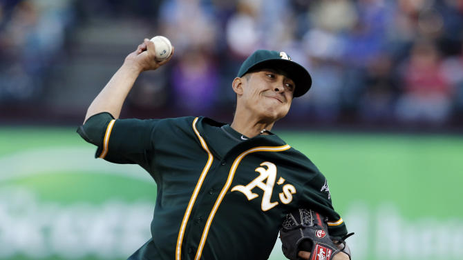 Chavez pitches A's to sweep of Rangers in 12-1 win