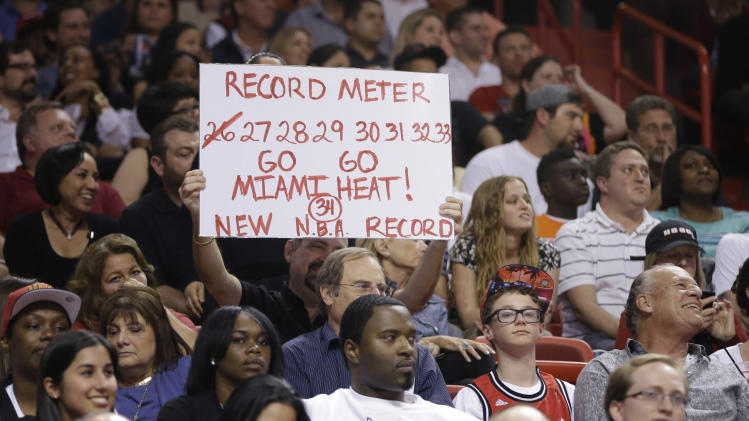 A Miami Heat fan displays a sign about the MiamI Heat's winning streak during the second half of a NBA basketball game in Miami, Friday, March 22, 2013 against the Detroit Pistons. The Heat won 103-89. (AP Photo/J Pat Carter)
