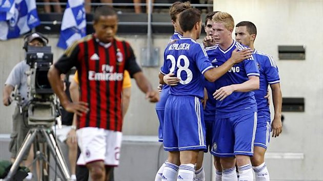 A.C. Milan's Urby Emanuelson (L) reacts as Chelsea's Kevin De Bruyne (2nd R) is congratulated by teammates after scoring a goal during the first half of their Guinness International Champions Cup match at MetLife Stadium in East Rutherford (REUTERS