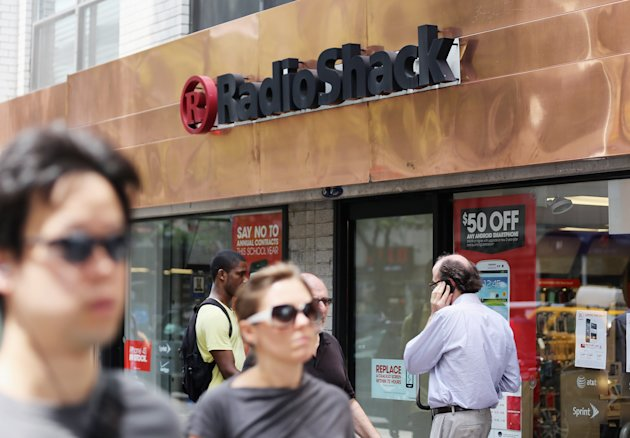 NEW YORK, NY - JULY 26:  People walk past a RadioShack store in Manhattan on July 26, 2012 in New York City. Following poor second quarter earnings, the electronics chain was hit with a ratings downgrade and shares fell to an all-time low.  (Photo by Mario Tama/Getty Images)