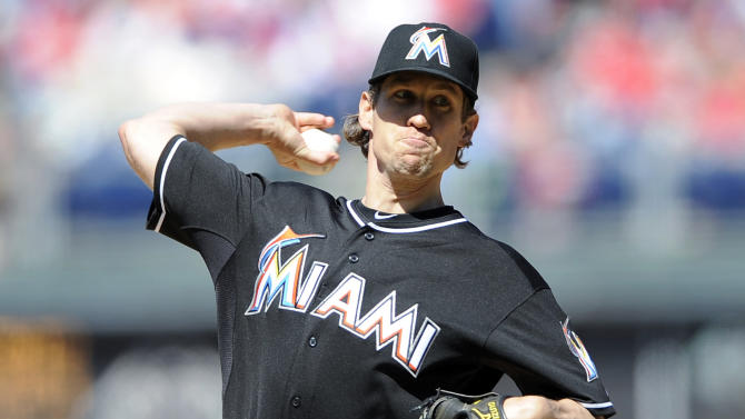 Miami Marlins' Kevin Slowey throws a pitch in the first inning of a baseball game against the Philadelphia Phillies, Sunday, May 5, 2013, in Philadelphia. (AP Photo/Michael Perez)