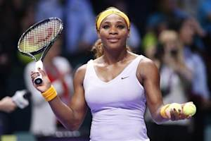 Williams of the U.S. throws balls to spectators after her WTA tennis championships match against Kerber of Germany at Sinan Erdem Dome in Istanbul