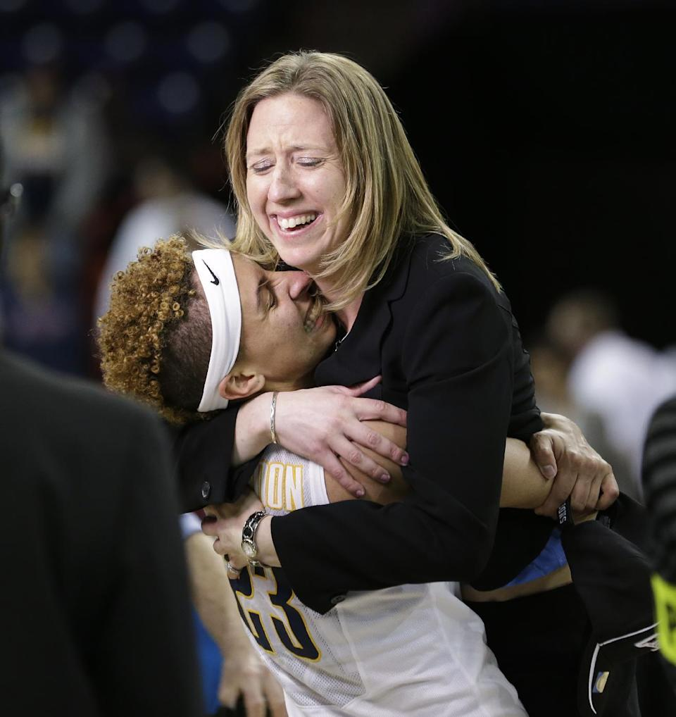 California head coach Lindsay Gottlieb, right, is embraced by Layshia Clarendon after the team beat Georgia in overtime in a regional final in the NCAA women's college basketball tournament, Monday, April 1, 2013, in Spokane, Wash. Cal won 65-62. (AP Photo/Elaine Thompson)