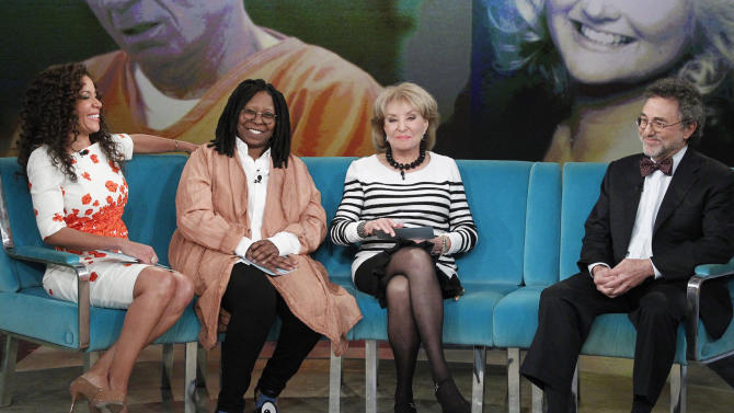 "This Wednesday, March 26, 2014 photo provided by ABC shows, from left, featured guest co-host, attorney Sunny Hostin, Whoopi Goldberg, Barbara Walters and Gerald Schwartzbach, on ""The View,"" during the career celebration all season featuring ""The Year of Barbara,"" a look back at many of her most notable interviews, originally featured on ABC's ""20/20."" Walters plans to make her final appearance on ""The View"" on May 16, part of a daylong retirement celebration that will include ABC News naming its New York headquarters after her. (AP Photo/ABC, Lou Rocco)"