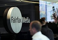 A man walks past signage in the foyer of the Sydney office of Fairfax Media on June 18, 2012. airfax Wednesday said editorial independence was at the core of the company, as mining magnate Gina Rinehart pushes for greater influence at the respected newspaper firm