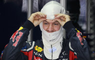 Red Bull driver Sebastian Vettel of Germany puts on a mask before the third free practice at the Interlagos race track in Sao Paulo, Brazil, Saturday Nov. 26, 2011. The Brazilian Formula One Grand Prix will take place on Sunday.(AP Photo/Victor R. Caivano)