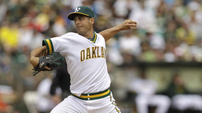 Oakland Athletics' Gio Gonzalez works against the Los Angeles Angels during the first inning Sunday, July 17, 2011, in Oakland, Calif. (AP Photo/Ben Margot)