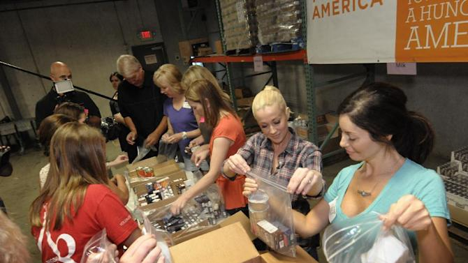 Country music recording artist Kellie Pickler (center) volunteers with teenagers at Second Harvest Food Bank of Middle Tennessee as part of the ConAgra Foods Foundation and Feeding America Hunger-Free Summer program launch on Tuesday, June 26, 2012 in Nashville, TN. (Dean Dixon/AP Images for ConAgra Foods Foundation)