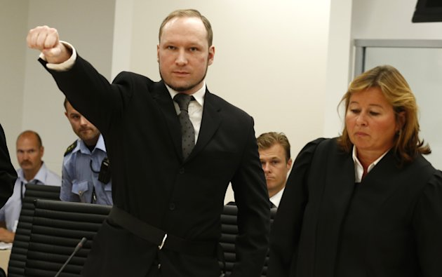 Mass murderer Anders Behring Breivik, makes a salute after  arrives at the court room in a courthouse in Oslo  Friday Aug. 24, 2012 .   Breivik, who admitted killing 77 people in Norway last year, dec