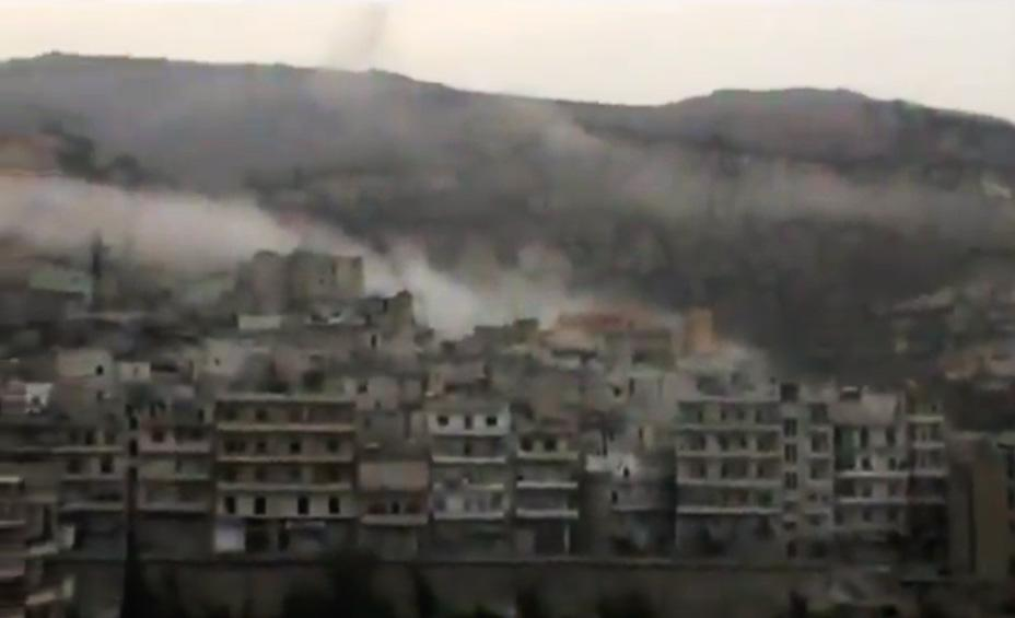 In this image taken from video obtained from the Shaam News Network, which has been authenticated based on its contents and other AP reporting, smoke rises from buildings due to government shelling in Idlib province, northern Syria, on Monday, Oct. 1, 2012. (AP Photo/Shaam News Network via AP video)