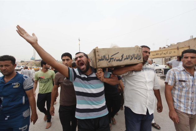 Relatives carry the coffin of an Iraqi police officer killed by militants, during a funeral in Najaf, around 160 km (99 miles) south of Baghdad