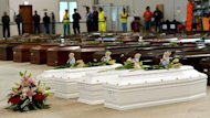 Coffins of victims including children in a hangar at Lampedusa airport on October 5, 2013