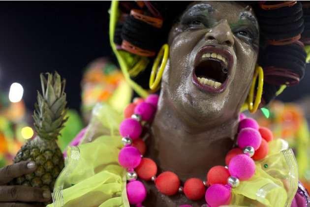 A performer from the Sao Clemente samba school parades during carnival celebrations at the Sambadrome in Rio de Janeiro, Brazil, Monday, Feb. 11, 2013. (AP Photo/Felipe Dana)