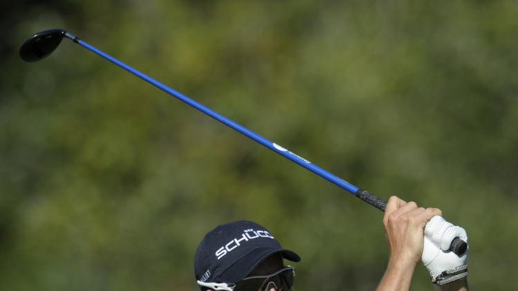 Henrik Stenson, of Sweden, watches his tee shot on the 11th hole during the second round of the Children's Miracle Network Classic golf tournament in Lake Buena Vista, Fla., Friday, Oct. 21, 2011.(AP Photo/Phelan M. Ebenhack)