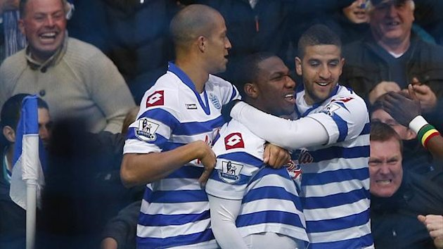 Queens Park Rangers' Junior Holett (C) celebrates his goal against Everton with Bobby Zamora (L) and Adel Taarabt (Reuters)