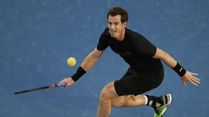 Andy Murray of Britain eyes up the ball for a return to Nick Kyrgios of Australia during their quarterfinal match at the Australian Open tennis championship in Melbourne, Australia, Tuesday, Jan. 27, 2015. (AP Photo/Vincent Thian)